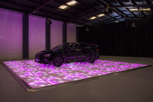 Pink LED with stars displaying car