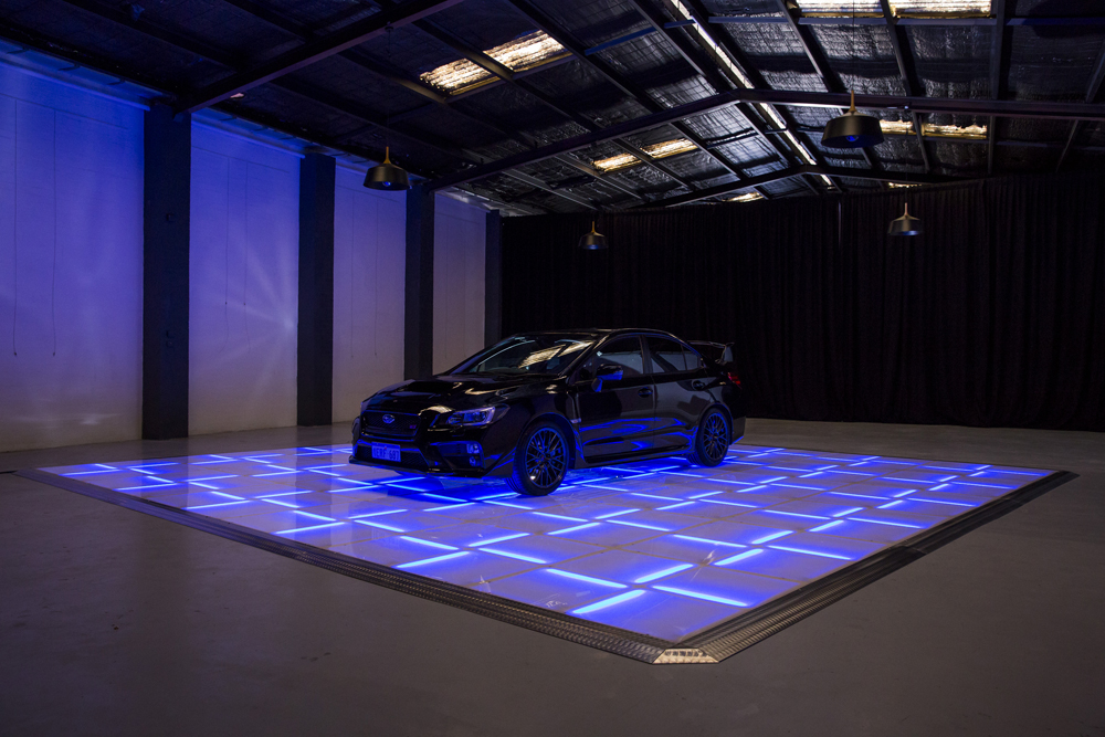 Blue and yellow LED with stars displaying car