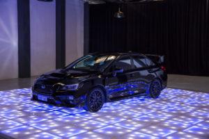 Car on LED dance floor