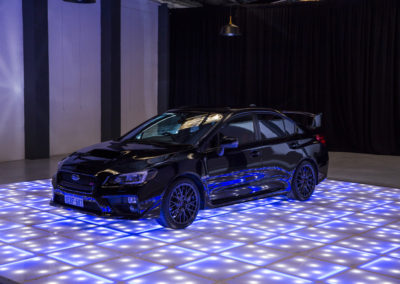 Car on LED dance floor