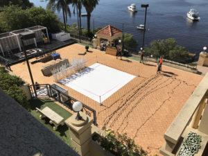 Parquetry dance floor on tennis court