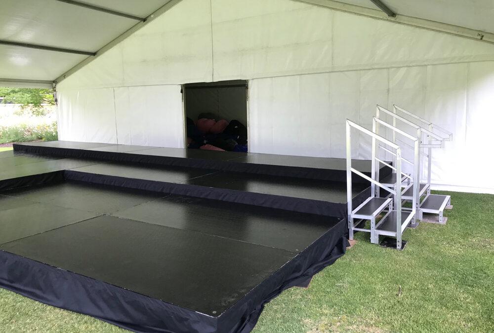 Stage on uneven ground under marquee