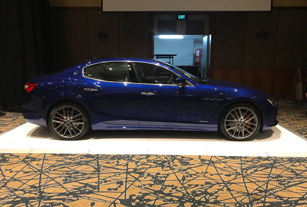 White gloss dance floor for Maserati car