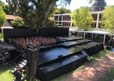 Multi-leveled stage outdoors on uneven ground