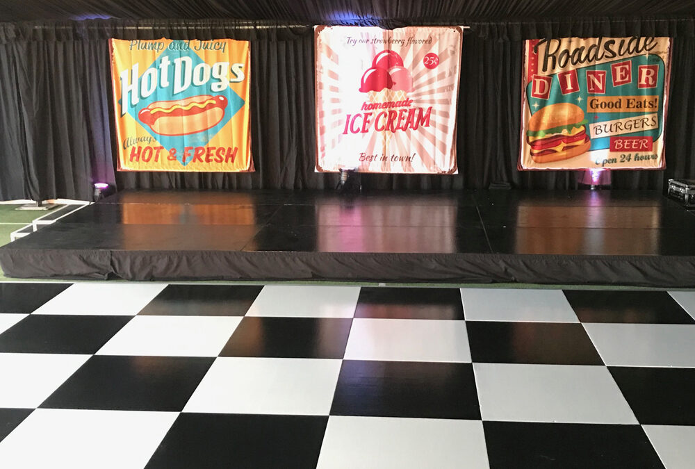 Dance floor for themed event inside a marquee