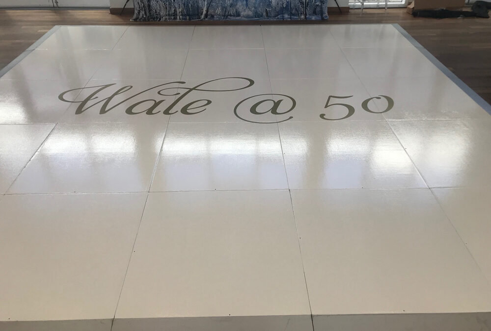 Private 50th birthday party dance floor with monogram
