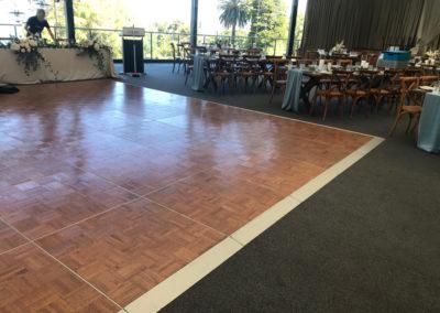 Dark oak parquetry dance floor