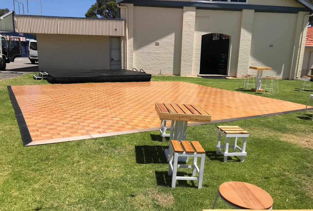 Corporate event with parquetry dance floor and stage
