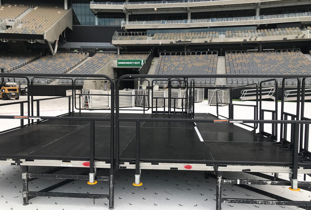Stage with guard rails