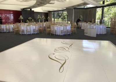 White gloss dance floor with monogram