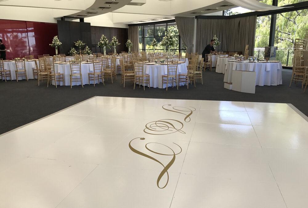 White gloss dance floor with monogram