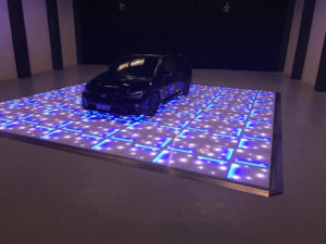 car on dance floor